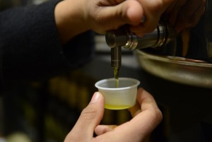 Seasons taproom hand with olive oil