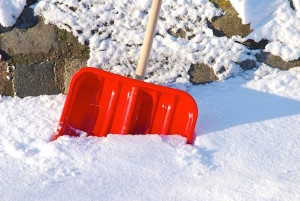 Snow and red shovel