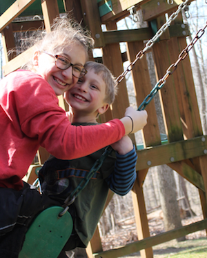 Girl and boy on swings
