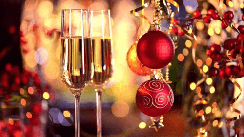 Wine glasses and holiday decorations