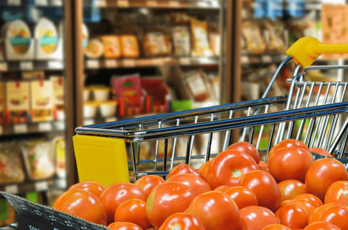 Supermarket cart with tomatoes